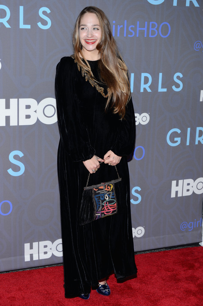 Jemima Kirke wore a longer, relaxed black maxi dress, but paired the darker designer with a very cool — albeit very bohemian-inspired — handbag.