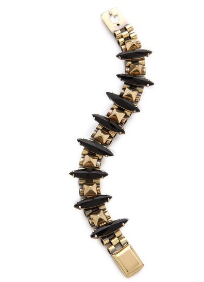 Stack this Iosselliani crystal shard bracelet ($375) with a few more bracelets for a more subversive look.