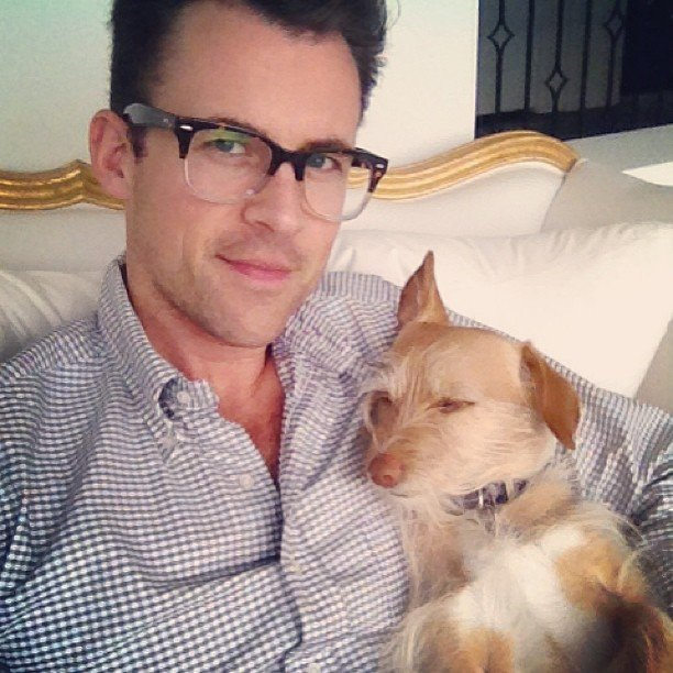 Brad Goreski cuddled up with his pup. Source: Twitter user mrbradgoreski