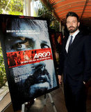 Ben Affleck posed next to an Argo poster.