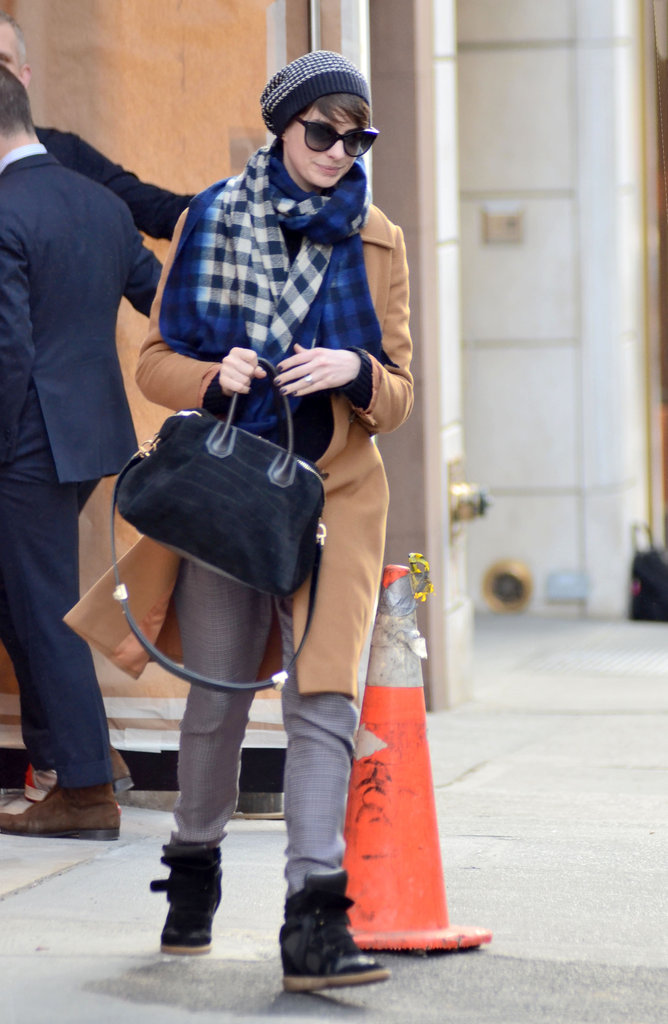 Anne Hathaway defied the Winter doldrums with a cool bit of street style, thanks to her beanie, checkered scarf, and sporty Isabel Marant sneakers.