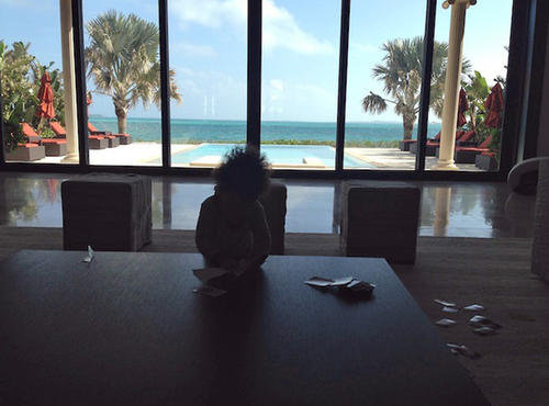 Jay-Z shared a vacation pic of 1-year-old Blue Ivy enjoying a game of Uno in the Bahamas. Source: Life+Times