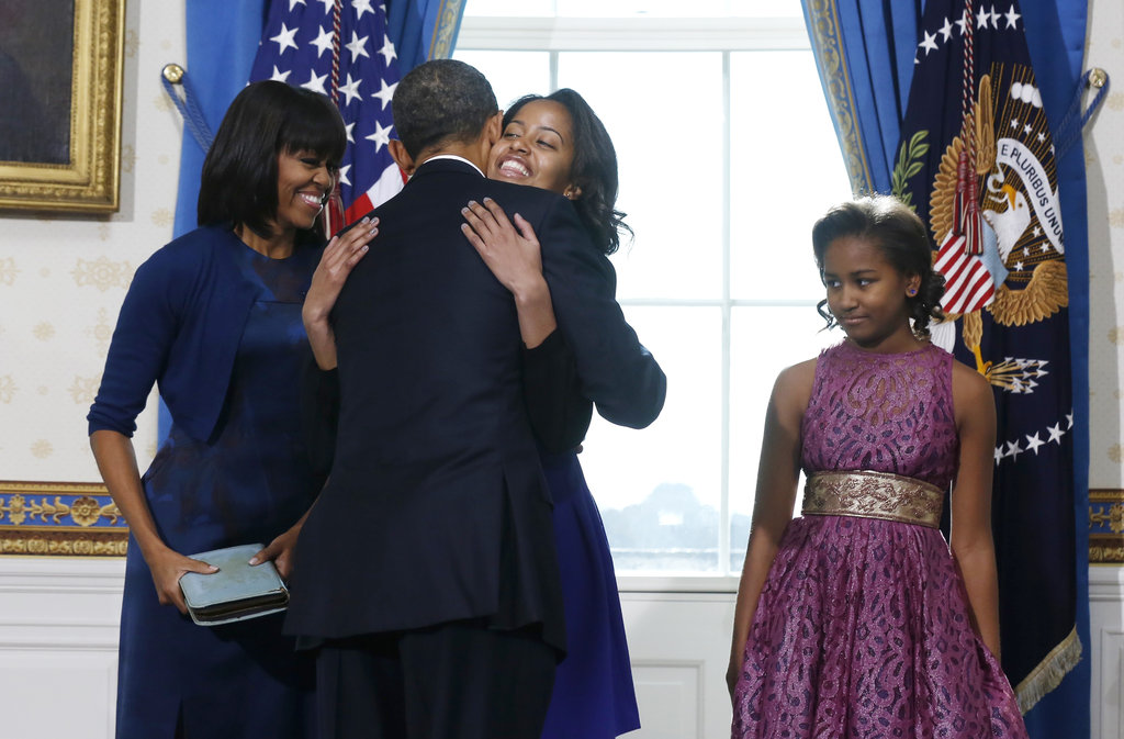The president received a hug from daughter Malia during his swearing-in ceremony.