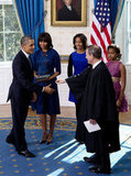 President Obama shook hands with US Supreme Court Chief Justice John Roberts after taking the oath of office.