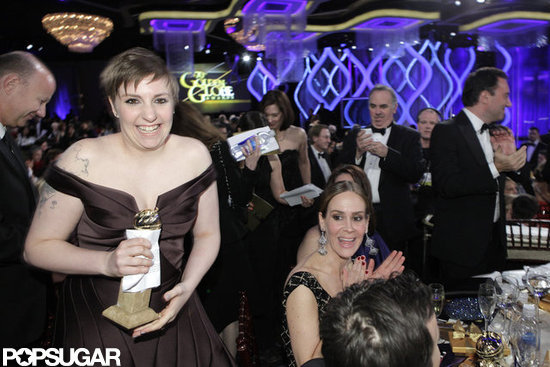 Lena Dunham smiled holding her Golden Globe.