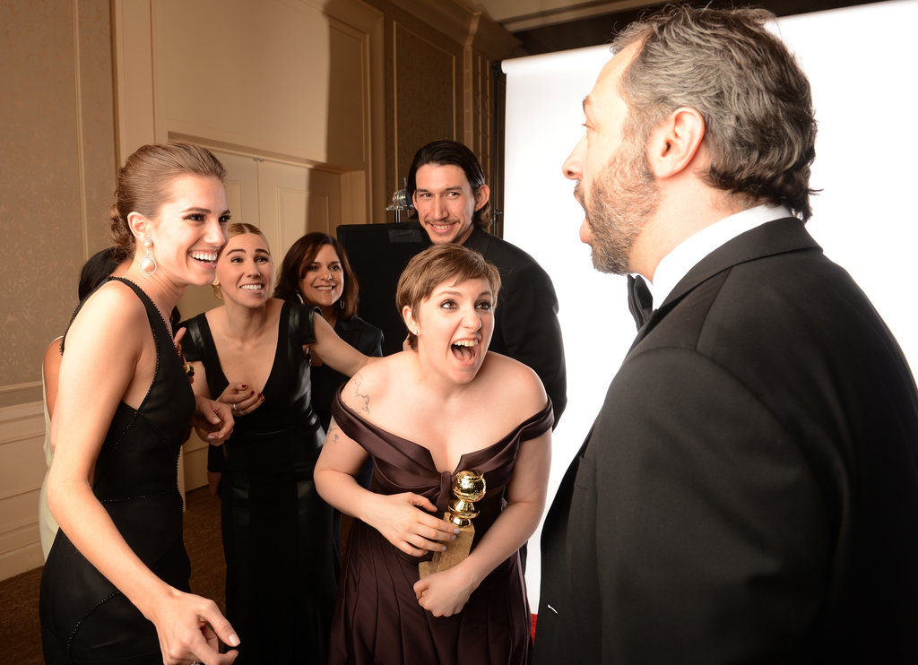 The cast of Girls showed their winning excitement with Judd Apatow in the press room at the Golden Globes.