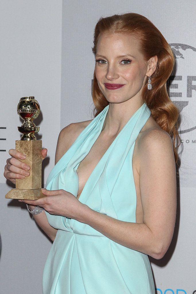 Jessica Chastain held up her Golden Globe.