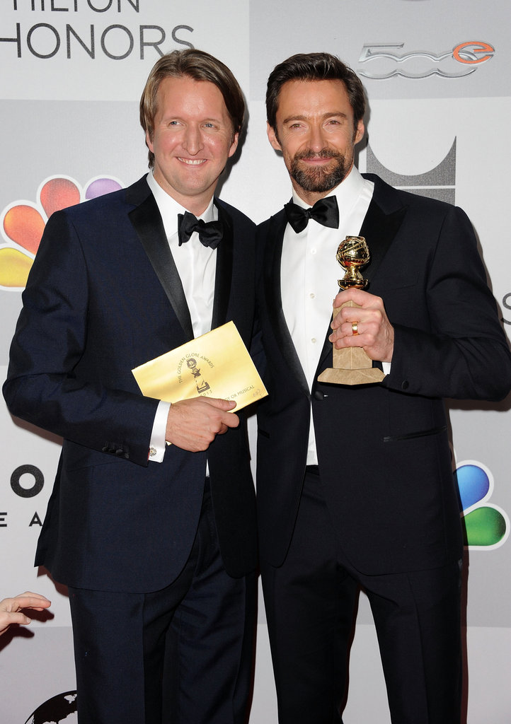 Hugh Jackman and Tom Hooper smiled with Hugh's award.