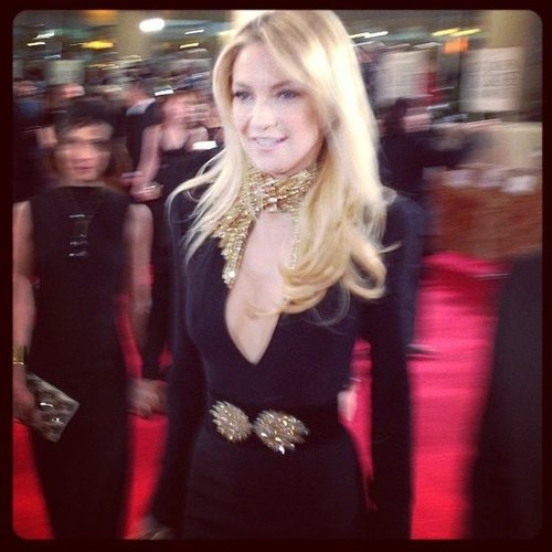 Kate Hudson looked sexy in a black and gold Alexander McQueen gown on the red carpet. Source: Instagram user rachel_roy