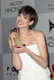 Anne Hathaway got giddy with her award.
