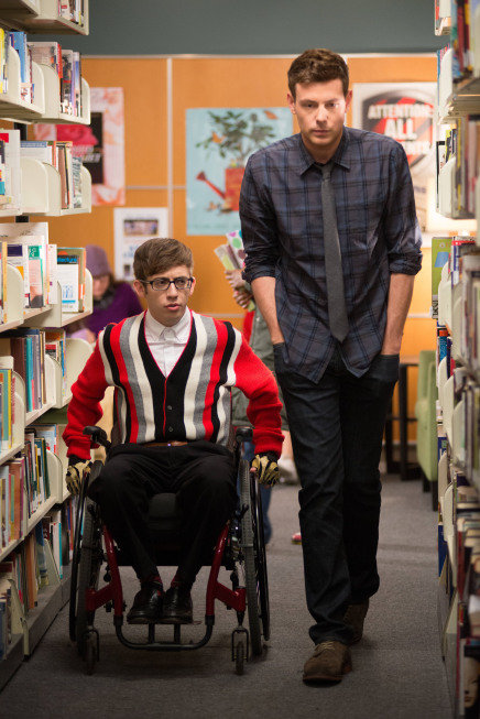 "Artie and Finn stroll the library in ""Naked."""