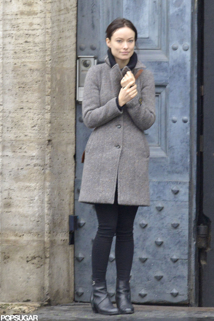 Olivia Wilde stood in a doorway in Rome.