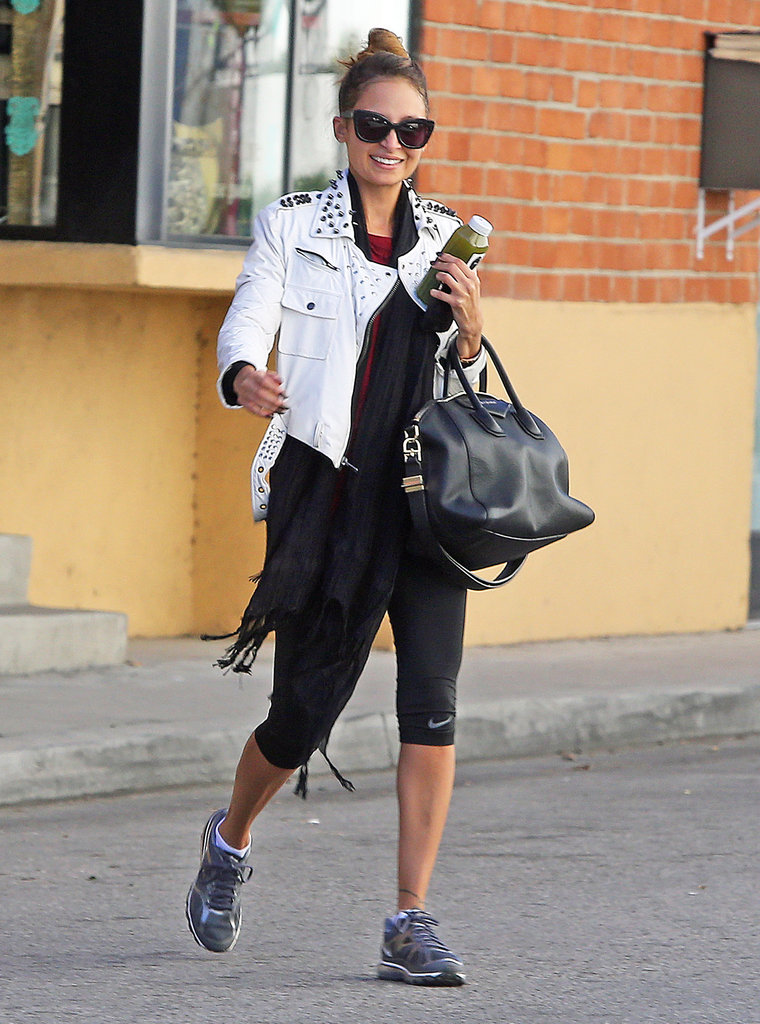 Nicole Richie pulled her hair up in a bun.