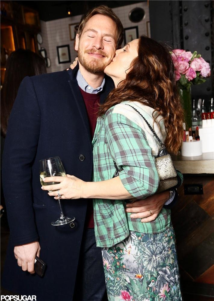 Drew Barrymore kissed Will Kopelman at the launch party for her cosmetics brand Flower Beauty in January 2013.