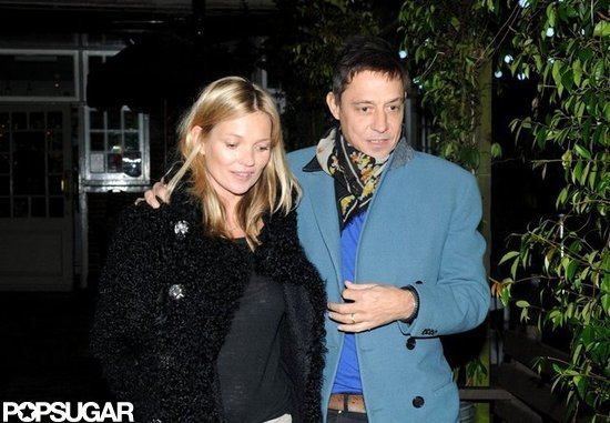 Supermodel Kate Moss and husband Jamie Hince kept warm leaving her 39th birthday dinner.