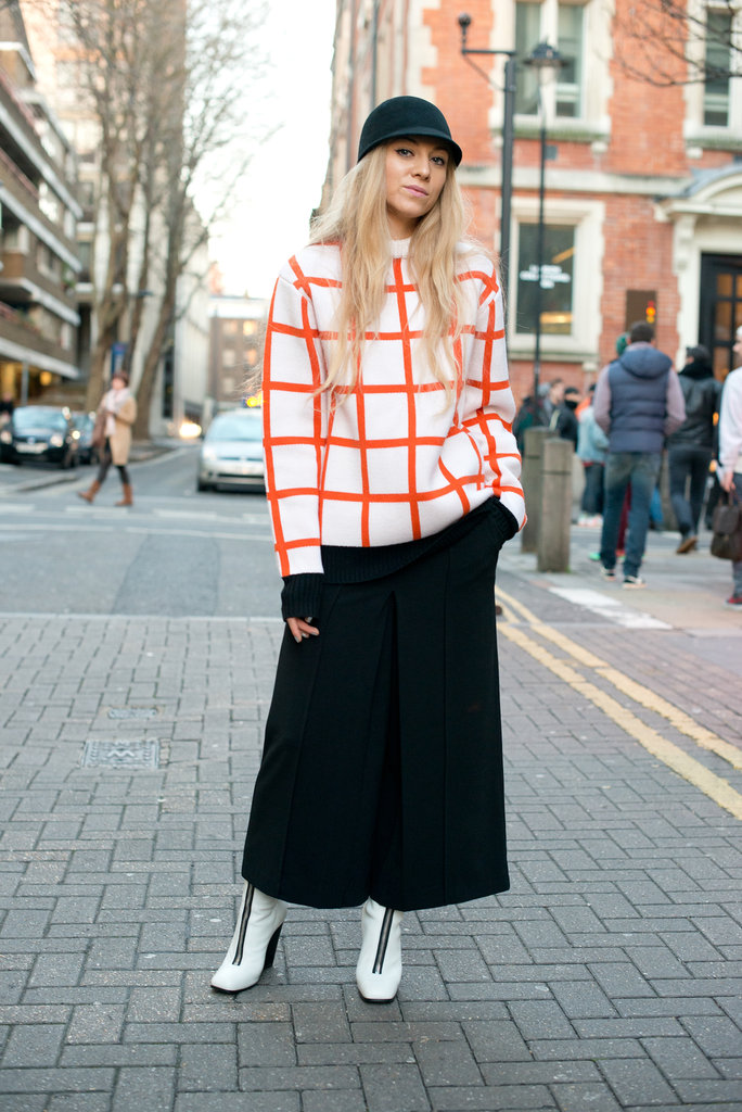 A right-on-trend windowpane sweater added to the mod effect of this styler's stark white boots.