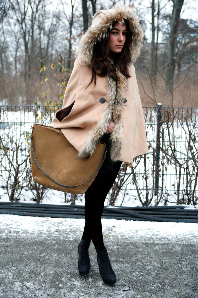 A luxe fur-trimmed cape coat offered just the right amount of drama to black tights and a classic tote.