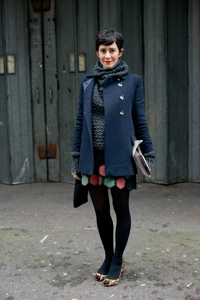 Quirky heels and a colorful mini countered a classic coat.