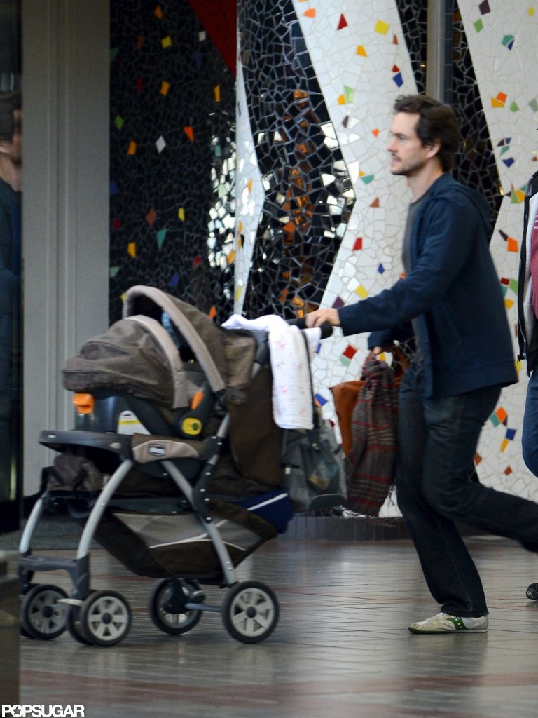 Hugh Dancy pushed his son, Cyrus, in his stroller.