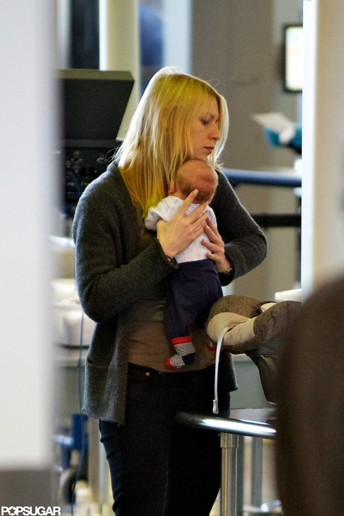 Claire Danes carried baby Cyrus through LAX.