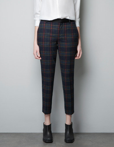 Instead of the usual pair of black pants, Zara's checked trousers ($40, originally $80) are a great 9-5 option.