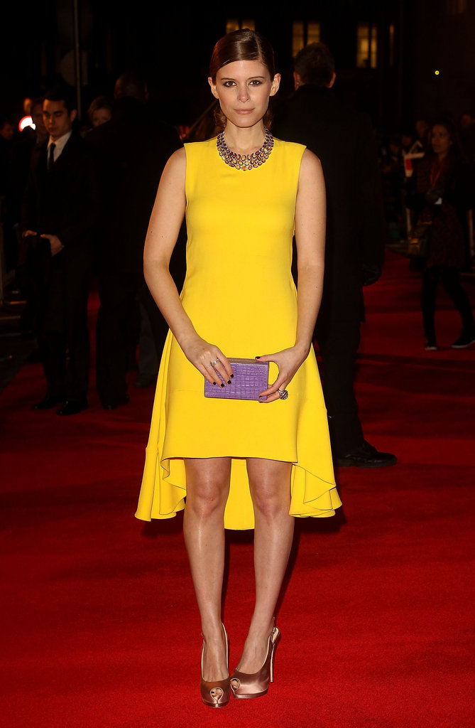 Kate Mara made a bright statement at the red-carpet premiere of Netflix original series House of Cards in a yellow Christian Dior dress. The best part? She partnered the slightly high-low silhouette with a killer pair of nude-colored satin pumps.