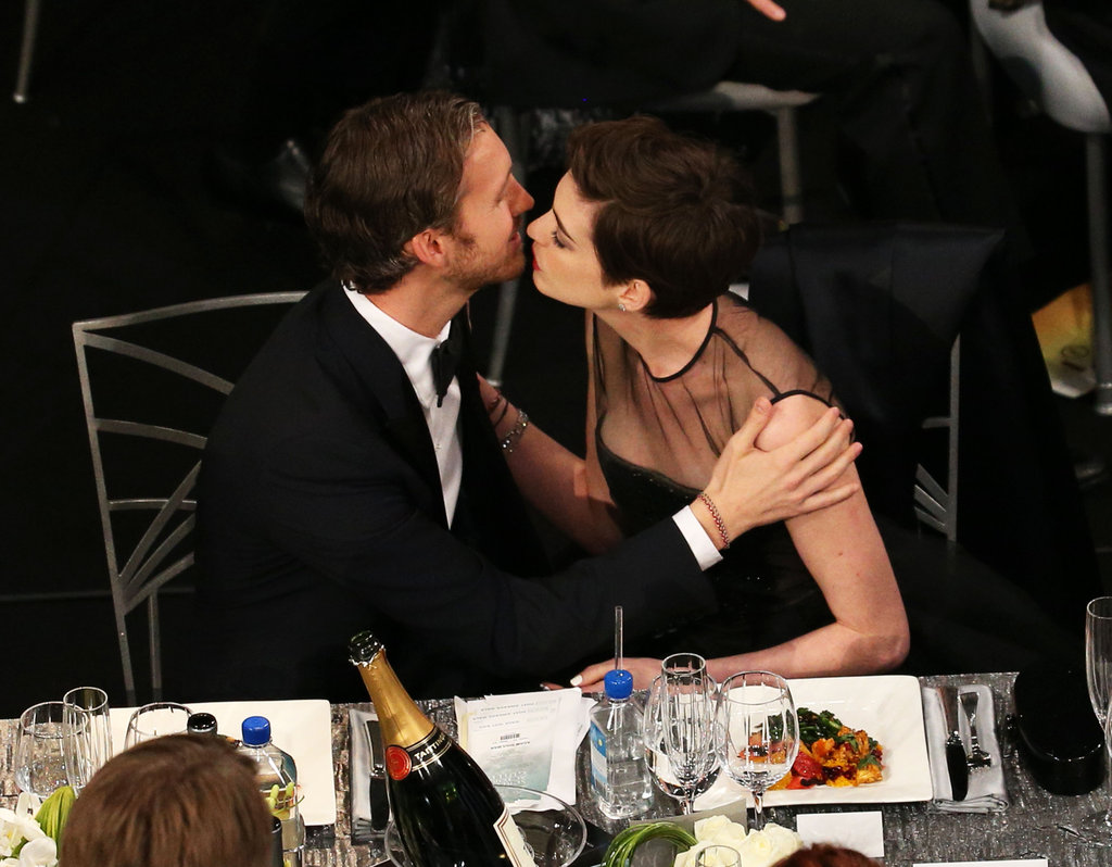 Adam Shulman kissed Anne Hathaway after her win.
