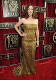 Jennifer Garner sparkled in gold on the red carpet at the SAG awards.