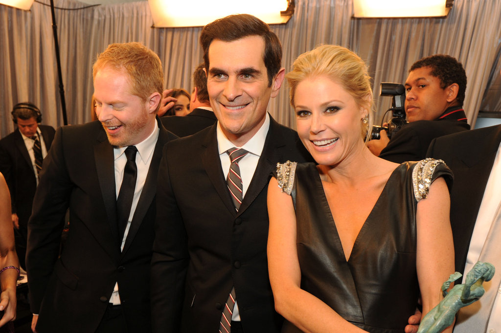 Modern Family's Jesse Tyler Ferguson, Ty Burrell, and Julie Bowen showed off their winning statue backstage.