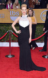 January Jones' black matte wrap gown with draped white organza by Prabal Gurung proved black and white is anything but boring.