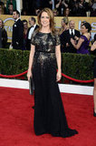 Jenna Fischer sparkled on the red carpet in a mixed-metal embellished gown with a metallic clutch.