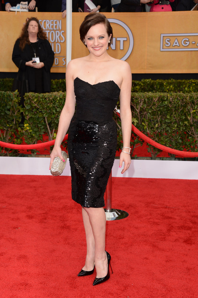 Elisabeth Moss opted for a Dolce & Gabbana cocktail dress to match her Jimmy Choo bag and diamond earrings.