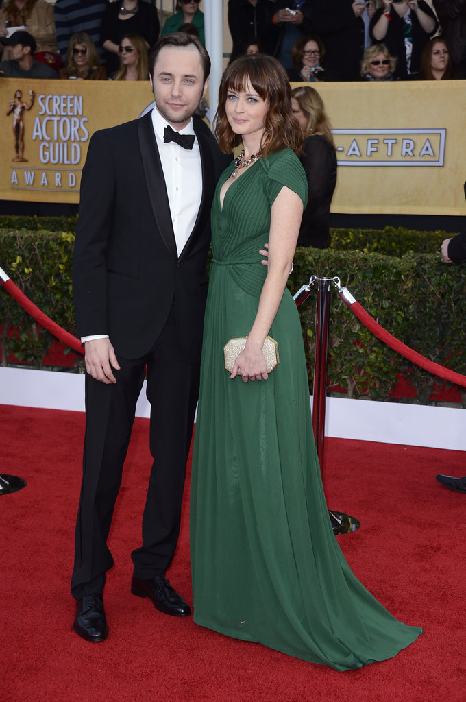 Alexis Bledel donned an emerald pleated gown by Rena Lange, shimmering clutch, and statement House of Lavande necklace.