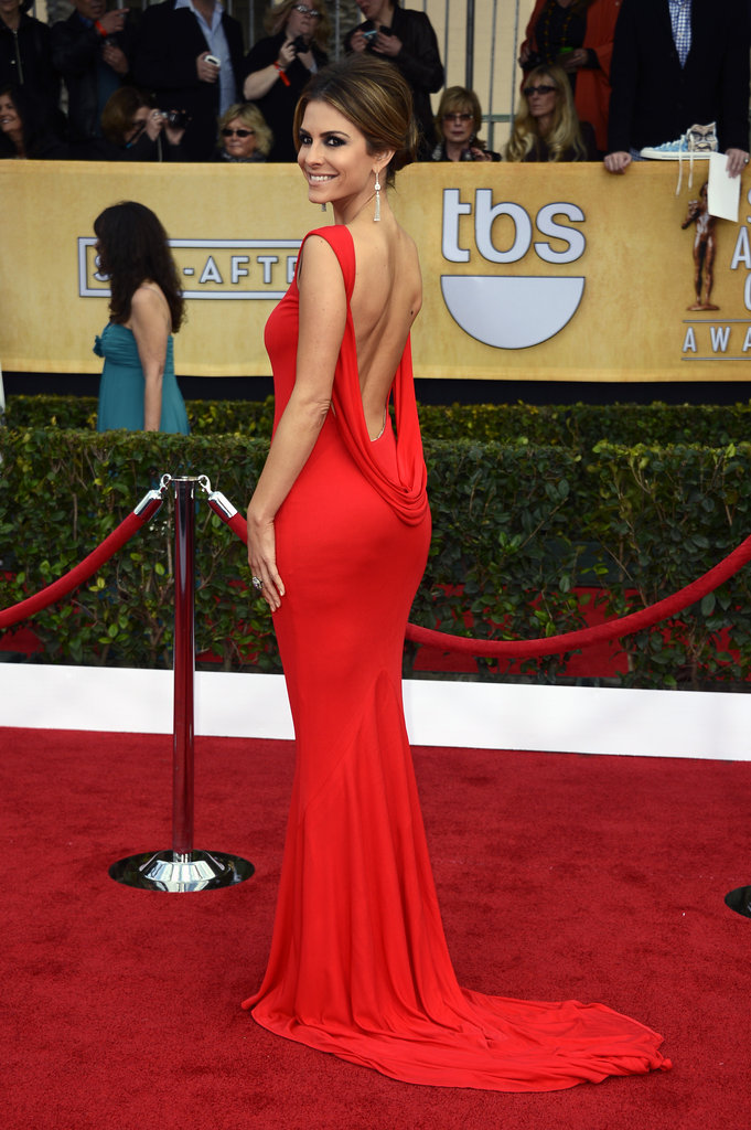 Maria Menounos brought sexy back in a fiery red confection by Randi Rahm and diamond drop earrings.