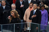 President Obama stood as Beyonce performed her rendition of the national anthem at the presidential inauguration Monday.