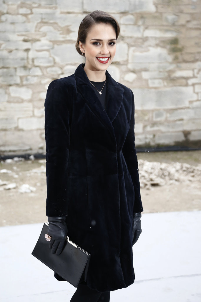 Jessica Alba kept warm in a coat.