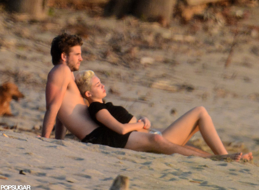 Miley Cyrus and Liam Hemsworth watched the sunset in Costa Rica while vacationing in January 2013.