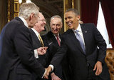 President Obama laughed with Senate Majority Leader Harry Reid, Senator Lamar Alexander, and Senator Chuck Schumer at the Capitol after signing the National Day of Hope and Resolve proclamation Monday.