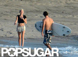 Miley Cyrus walked along the beach.