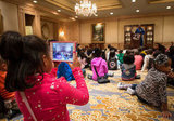 A girl records astronaut Leland Melvin (on her iPad mini!) during a STEM education event at the Ritz-Carlton Hotel during inauguration weekend.  Source: Flickr User NASA HQ