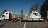 A replica of the Orion Multi-Purpose Crew Vehicle heads to the parade staging area.  Source: Flickr User NASA HQ