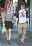 Emma Roberts edged up her low-key LA look with studded Chloé boots and white cat-eye shades.