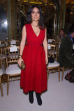 Salma Hayek stood out from the (front row) crowd of Giambattista Valli's couture show in a plunging red midi dress.