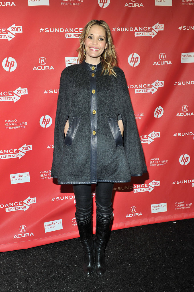 Leslie Bibb was all smiles in a navy Tory Burch cape, coated Level 99 denim, and sleek leather boots at the premiere of Hell Baby.