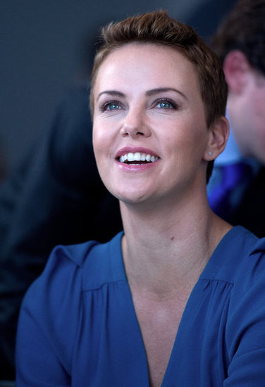 Charlize Theron's pixie cut had grown out a bit.