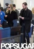 Kate Bosworth and Michael Polish went through airport security.
