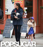 Katie Holmes wore a Balenciaga coat while she walked with Suri Cruise.