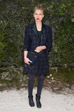 Clémence Poésy toughened up a plaid ensemble with black jeans and black flat moto boots at Chanel.