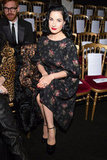 Spotted: Dita Von Teese — at the Ulyana Sergeenko show — in a feminine floral-printed sheath and ankle-strap heels, a sweet departure from her usual body-con silhouettes.