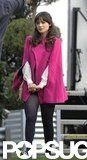 Zooey Deschanel wore a pink cape while filming.